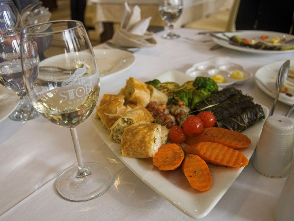 White wine in glass together with food on a restaurant in Stoby winery, Macedonia.
